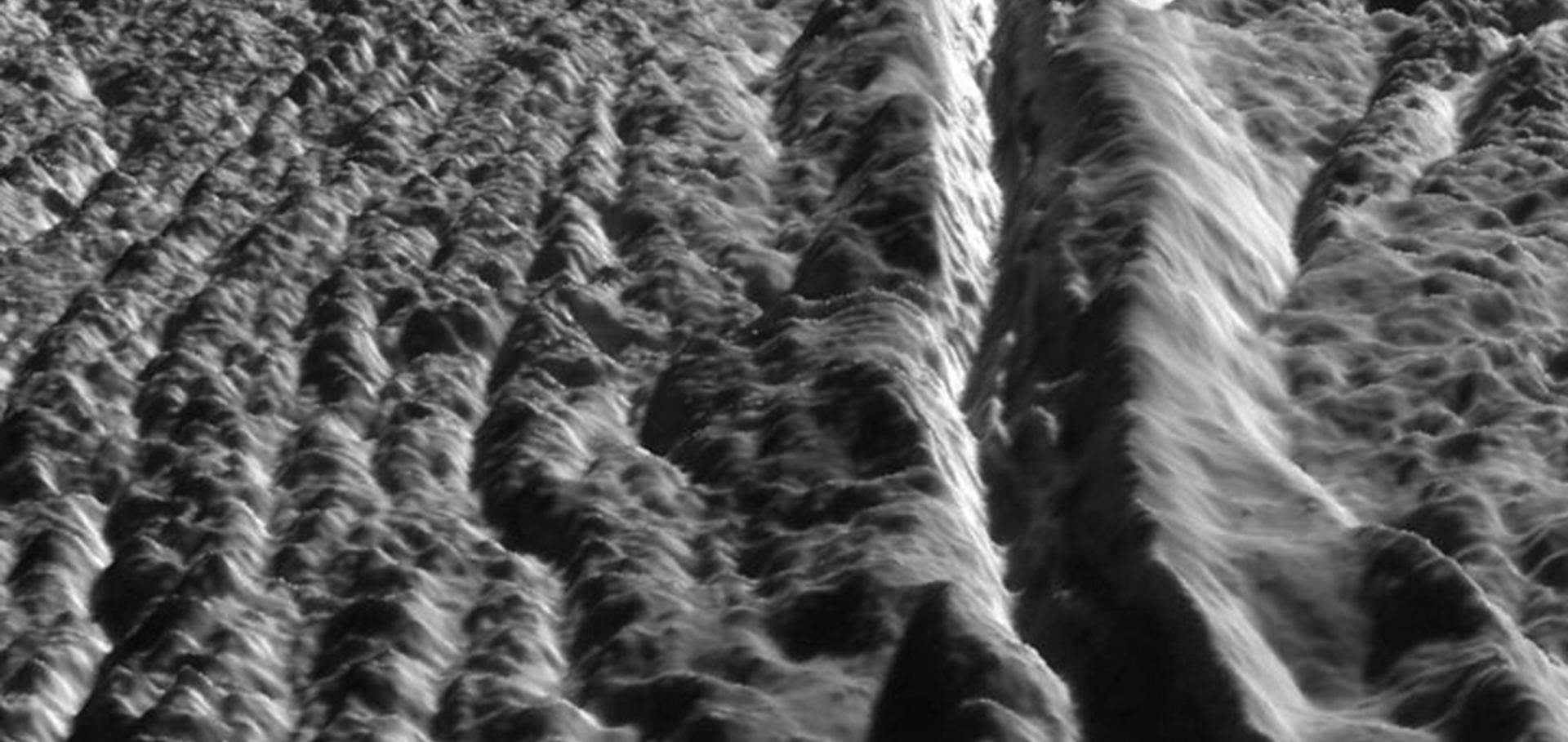 Enceladus' Damascus Sulcus. This image was generated by combining high resolution images of Enceladus acquired in August 2008 at 12 to 30 meters (40 to 100 feet) resolution with a topographic map.