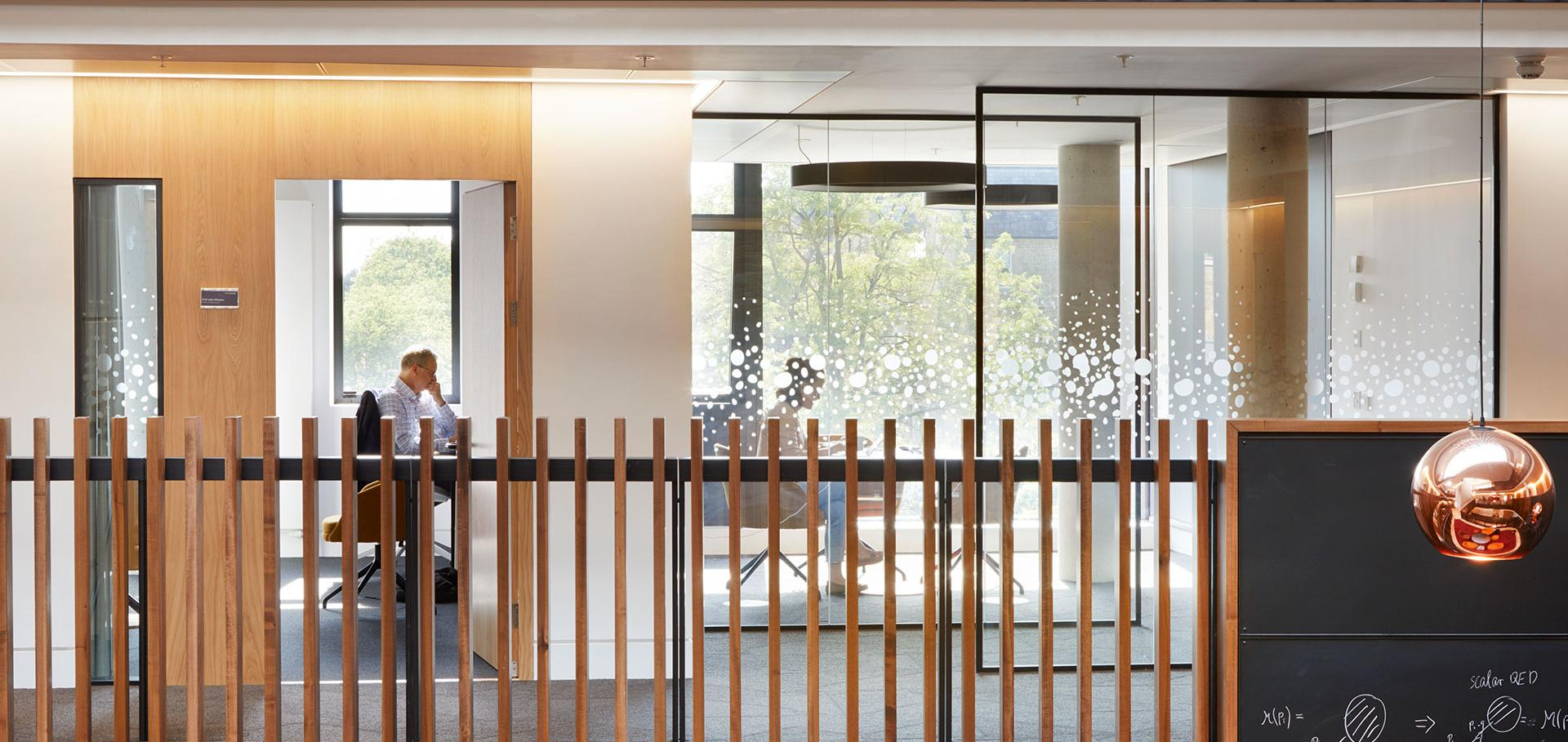 Man at desk in office, Beecroft building, University of Oxford